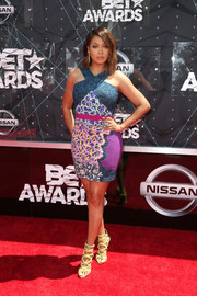 La La Anthony showed off her curves and her bold style with this body-con mixed-print mini dress by Peter Pilotto at the BET Awards.