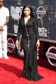 Nicki Minaj looked vampy, as always, in a curve-hugging black lace gown by Givenchy at the BET Awards.
