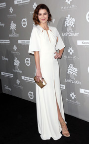 Mary Elizabeth Winstead looked simply divine at the Baby2Baby Gala in a white Halston Heritage gown with a capelet, a slashed neckline, and a high front slit.