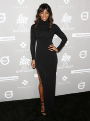 Kelly Rowland cut a shapely figure at the Baby2Baby Gala in a body-con black turtleneck dress with a high side slit.