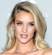 Rosie Huntington-Whiteley looked like a living Barbie doll with her beautiful blonde waves at the Baby2Baby Gala.