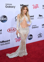 Jennifer Lopez isn't done with the sheer trend just yet. For her Billboard Music Awards look, she sizzled in a Charbel Zoe sequined gown that barely covered up her assets.