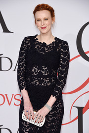 Karen Elson contrasted her sexy lace dress with an edgy studded clutch for the CFDA Fashion Awards.