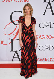 Karlie Kloss donned a sweet-meets-sexy Diane von Furstenberg polka-dot gown with a down-to-there neckline for the CFDA Fashion Awards.