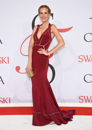 Petra Nemcova looked ravishing at the CFDA Fashion Awards in a wine-colored Max Azria Atelier gown accented with sheer inserts.