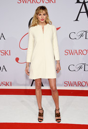 Jessica Hart kept it basic in a long-sleeve white mini dress by The Row at the CFDA Fashion Awards.