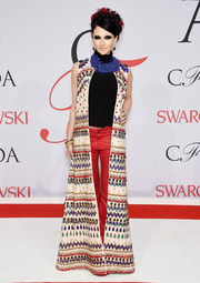 Stacey Bendet brought some '70s-era funkiness to the CFDA Fashion Awards with this floor-length beaded coat, crop-top, and leather pants combo.
