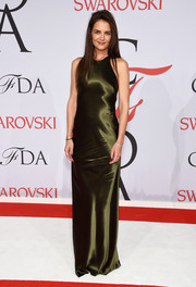 Katie Holmes went for understated sophistication at the CFDA Fashion Awards in a fluid forest-green column dress by Ralph Lauren.