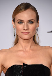 Diane Kruger looked very pretty at the CFDA Fashion Awards even with this simple half-up hairstyle.
