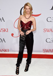 January Jones complemented her jumpsuit with edgy black strappy sandals by Paul Andrew.