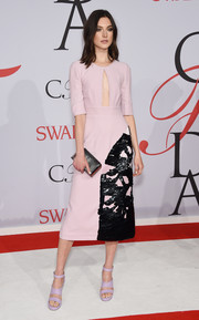 Jacquelyn Jablonski chose a pink dress with a keyhole cutout and black detailing on the skirt for her CFDA Fashion Awards look.