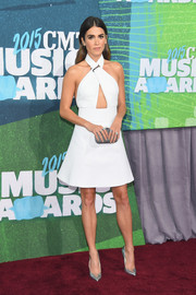 Nikki Reed injected a hint of shine via a pair of silver Brian Atwood pumps.