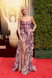 Heidi Klum went for a whimsical-meets-sexy look in a high-low purple corset gown by Atelier Versace at the Creative Arts Emmy Awards.