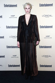 Gwendoline Christie went for boudouir glamour in a robe-like evening dress by Giles Deacon during the Entertainment Weekly pre-Emmy party.