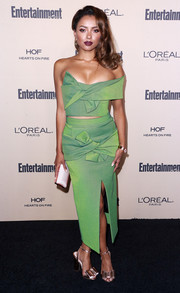 Kat Graham worked a bowed green off-one-shoulder crop-top by Maticevski at the Entertainment Weekly pre-Emmy party.