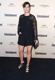 Black strappy sandals completed Marcia Gay Harden's look.