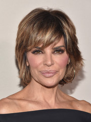 Lisa Rinna's layered razor cut looked tamer than usual when she attended the 2015 Entertainment Weekly pre-Emmy party.