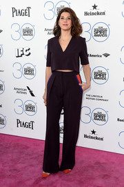 Marisa Tomei opted for a matchy-matchy finish with a pair of dark purple Roksanda slacks. Colorful pocket detailing broke up the monotony.