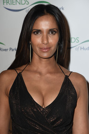 Padma Lakshmi styled her look with a pair of gold spike earrings.
