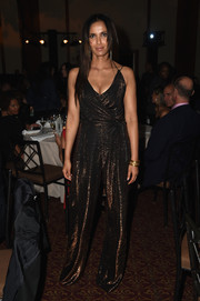 Padma Lakshmi shimmered in a bronze wrap-bodice jumpsuit during the Friends of Hudson River Park Gala.