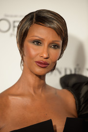 Iman wore her short hair neatly slicked down with a side part during the Glamour Women of the Year Awards.