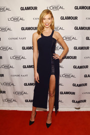 Karlie Kloss showed major leg at the Glamour Women of the Year Awards in a midnight-blue Mugler halter dress with an up-to-there slit.