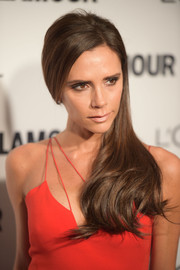 Victoria Beckham wore her long locks neatly swept to the side when she attended the Glamour Women of the Year Awards.
