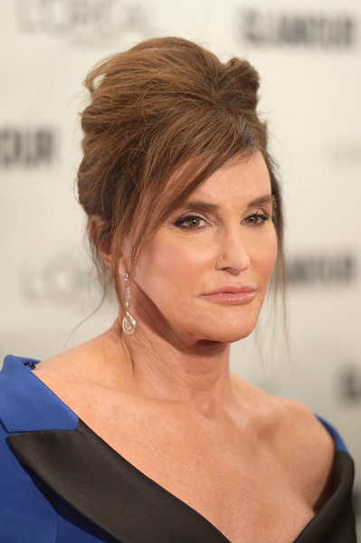 Caitlyn Jenner teased her locks into a towering beehive for the Glamour Women of the Year Awards.