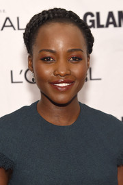 Lupita Nyong'o perked up her beauty look with bright orange eyeshadow.