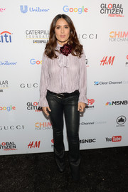 Salma Hayek kept it modest in a loose, long-sleeve lavender blouse at the Global Citizen Festival.