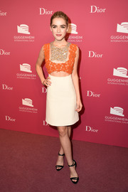 Kiernan Shipka looked downright fab at the Guggenheim International Gala pre-party in a Dior Couture dress featuring a midriff cutout, floral embroidery, and sequin bib detailing.