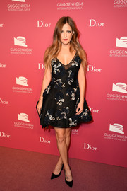 Riley Keough got all dolled up in a Dior fit-and-flare dress adorned with rosettes and silver beading for the Guggenheim International Gala pre-party.
