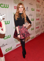 Katherine McNamara paired her top with a flounced floral printed mini skirt that added a festive look to her outfit.