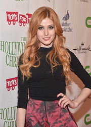 Katherine McNamara styled her hair in long loose curls that flowed past her shoulders for an effortless look