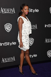 Aja Naomi King struck a pose on the InStyle and Warner Bros. Golden Globes purple carpet wearing a floral-beaded mini dress by Tracy Reese.