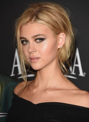 Nicola Peltz attended the InStyle and Warner Bros. Golden Globes party rocking a grunge-chic updo.