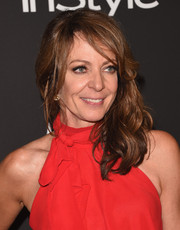 Allison Janney sported mildly messy waves with side-swept bangs during the InStyle and Warner Bros. Golden Globes party.