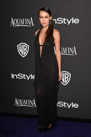 Maggie Q sent temperatures rising at the InStyle and Warner Bros. Golden Globes party in a deep-V halter gown rendered in a sheer fabric and a cascade of fringes.