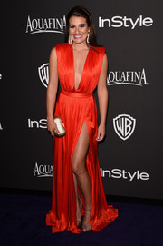 Lea Michele put on a major display of skin at the InStyle and Warner Bros. Golden Globes party in a red-hot Emanuel Ungaro gown with a very deep-V neckline and a hip-grazing slit.