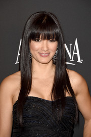 Kelly Hu looked cute with her long straight hair and eye-skimming bangs at the InStyle and Warner Bros. Golden Globes party.