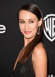 Maggie Q teamed her 'do with a pair of geometric earrings.
