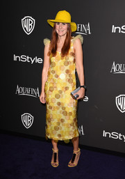 Nikki Pennie looked whimsical at the InStyle and Warner Bros. Golden Globes party in a yellow dress printed with overlapping polka dots.