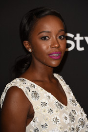 Aja Naomi King sported a girl-next-door ponytail during the InStyle and Warner Bros. Golden Globes party.