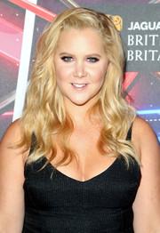 Amy Schumer left her long blonde waves loose when she attended the Britannia Awards.