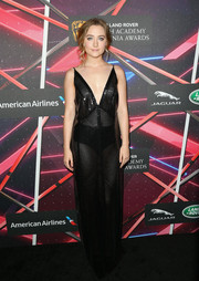 Saoirse Ronan showed her sultry side in a Calvin Klein sheer, sequined gown with a deep-V neckline during the Britannia Awards.