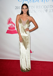 Genesis Rodriguez was a head turner at the Latin Grammy Person of the Year event in a slinky gold gown with a cleavage-baring mesh panel.