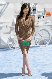 Ashley Rickards looked phenomenal in a gold wrap dress by Elisabetta Franchi at the MTV Movie Awards.