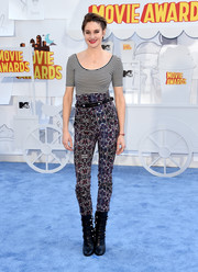 Shailene Woodley pulled off clashing prints with this striped top and high-waisted pants combo.