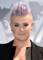 Kelly Osbourne attended the MTV Movie Awards rocking her signature lavender fauxhawk.