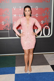 Demi Lovato put her curves on display in a geometric-patterned pink mini dress by Nicolas Jebran Couture at the MTV VMAs.